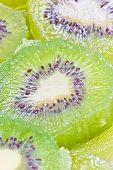 Full Frame Of Green Kiwi Fruit Sliced.