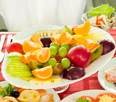plate full of fruit on the banquet table