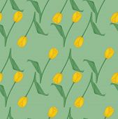 Seamless green background with yellow tulips.