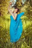 Girl In A Beautiful Blue Fluttering Dress.