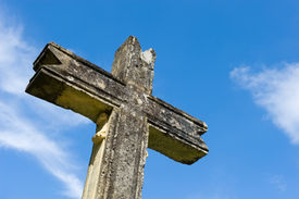 picture of domme  - An old cross made of stone in the ancient city of Domme in France - JPG
