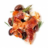 Shrimps with bacon, olives and rosemary, isolated on white background