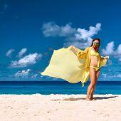 Woman with sarong at Seychelles beach