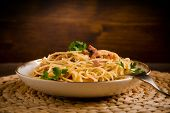 foto of carbonara  - Delicious spaghetti with bacon and egg called alla carbonara on wooden table - JPG