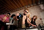 stock photo of lps  - Cool DJ with vest and female admirers - JPG