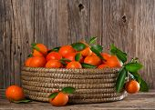 Tangerines Or Mandarins With Leaves In A Great  Basket On A Wooden