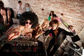 stock photo of lps  - Female DJs checking out the scene at a 1970s Disco Music Party - JPG