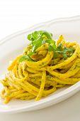 Pasta With Saffron And Arugula Pesto Isolated