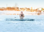 winter recreation - swimming in  ice-hole