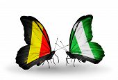 Two Butterflies With Flags On Wings As Symbol Of Relations Belgium And Nigeria