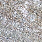texture and seamless background of white granite block stone