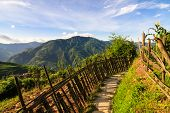 stock photo of wooden fence  - Chinese mountains and stone pathway with wooden fence - JPG
