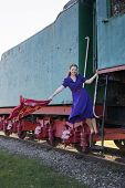 Woman At Lilac Dress On Moving Train