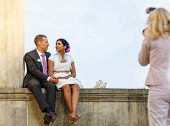 image of love making  - Beautiful indian bride and caucasian groom after wedding ceremony - JPG