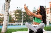 Woman Taking Selfies