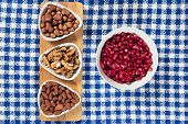 Varieties of nuts: almonds, hazelnuts and walnuts and pomegranate