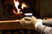 Hot Drink Holding Hands By The Fireplace