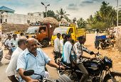 Thanjavour, India - February 13: An Unidentified Indian Riders Ride Motorbikes On Rural Road. India,