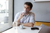 picture of vapor  - Close up portrait of a young man smoking vapor cigarette indoors - JPG