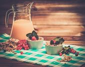 Healthy breakfast with fresh orange juice in wooden rural interior