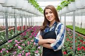 Young woman in a greenhouse with flowers