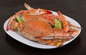 picture of cooked blue crab  - Boiled crabs with lime on the wood background
