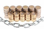 Coins organized in columns and rows protected by massive metal chain isolated on white background