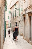 Mother And Daughter Walking The Streets Of The Old Town