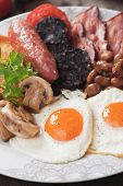 Full english breakfast with scrambled egg, bacon, mushrooms, sausage and kidney beans