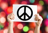 Peace Symbol card with colorful background with defocused lights