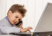 little boy on a laptop, symbol of the internet, e-commerce, consumer behavior, surfing