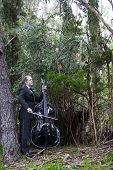 pic of double-bass  - man in tuxedo playing the double bass in park - JPG