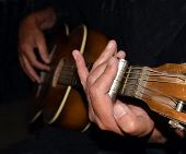 Постер, плакат: Playing Slide On Old Guitar Closeup