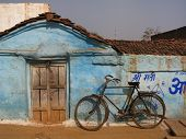 Old fashioned bicycle leaning against wall in India
