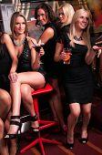 Girls company having fun in the night club