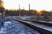 Winter Sunset On Railroad In Countryside