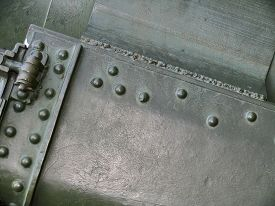 picture of abrasion  - Metallic texture with elements of rivets welds and abrasions on surface - JPG
