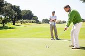 pic of take off clothes  - Golfing friends teeing off at the golf course - JPG