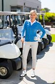 pic of buggy  - Female golfer beside golf buggy at the golf course parking - JPG