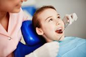 pic of oral  - Pretty child with open mouth during oral checkup - JPG
