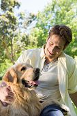picture of dog park  - Happy man with his pet dog in park on a sunny day - JPG