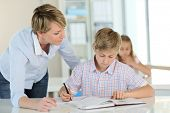 picture of schoolboys  - Teacher with schoolboy in classroom - JPG