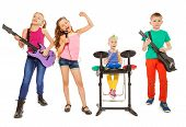 image of singing  - Four children perform together as rock group and girl singing as vocalist in front on white background - JPG
