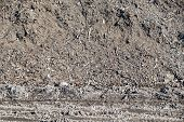 picture of dump  - dirty soil and construction garbage in a heap on a big dump for an abstract background of ecology of the nature - JPG