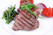 picture of sweet pea  - roasted beef meat strips steak on white ceramic plate with sweet pea and tomatoes isolated over white background - JPG
