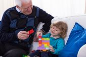 picture of grandpa  - Grandpa and grandchild playing with colorful blocks - JPG
