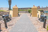 foto of cannon  - Historic cannons and lions guarding the main entrance to the Castle of Good Hope - JPG