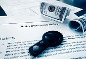 stock photo of key  - Auto insurance policy with cash and car key - JPG