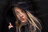 image of scared  - scared girl in black hood in dark - JPG