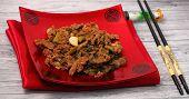 image of stir fry  - Vietnamese beef stir fry served on a wood table top  - JPG